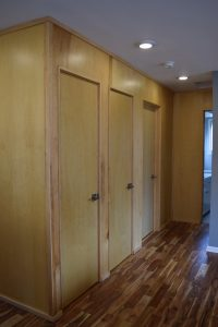 closet wall; covered with wood for a seamless look